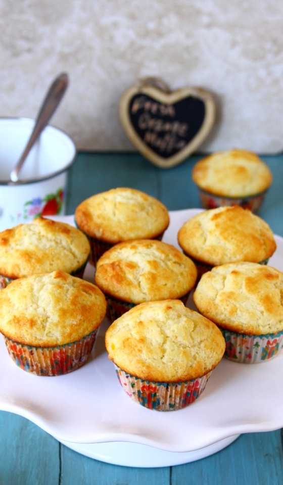 Orange Muffins Made With Greek Yogurt And Topped With A Light Glaze